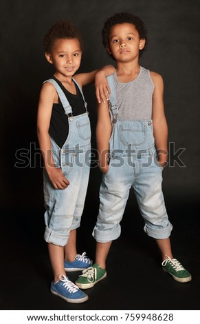 Mixed brothers twins. Brothers in denim. denim overalls. Handsome kids. Kids in denim.
