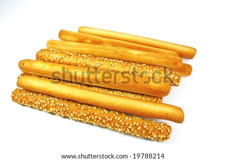 mixed butter and sesame bread sticks isolated on white background - stock photo