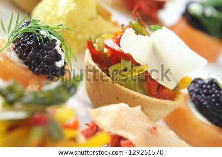 mixed canapes on platter - stock photo