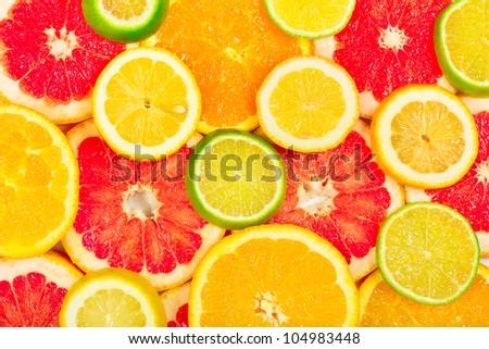 Mixed citrus fruit as background - stock photo