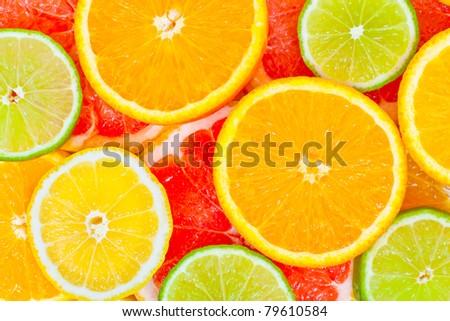 Mixed citrus fruit background - stock photo