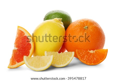 Mixed citrus fruit including lemon, lime, orange, tangerine and slices isolated on a white background, close up