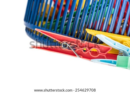 mixed clothespins with plastic basket isolated on white background - stock photo