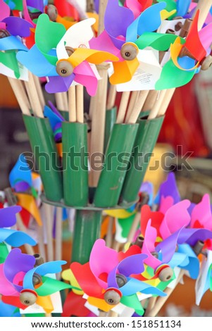 Mixed color Pinwheels, toy fans(with clipping path) Italy - stock photo