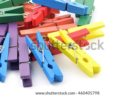 Mixed color wooden pegs isolated on white background