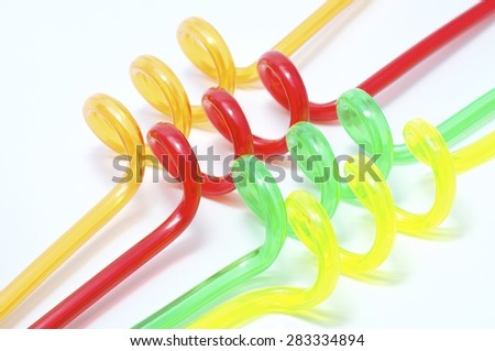 Mixed colored, turbinated straws on the white background.  - stock photo
