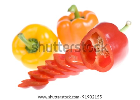 Mixed colorful bell peppers on white background