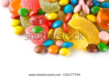 Mixed colorful candies on white background - stock photo