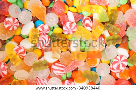 Mixed colorful fruit candies and jellies as background - stock photo