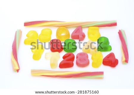 Mixed colorful jelly candies on white background.