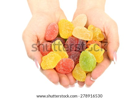 Mixed colorful sweets in hands isolated - stock photo