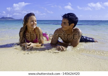 mixed couple at the beach in hawaii - stock photo