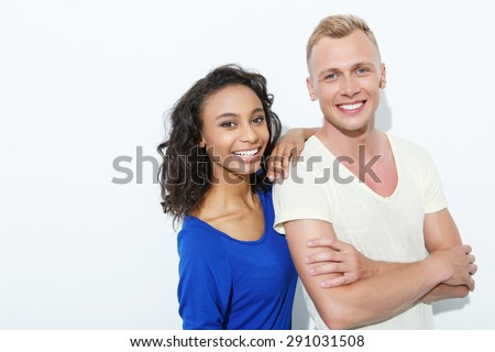 https://thumb1.shutterstock.com/display_pic_with_logo/90989/291031508/stock-photo-mixed-couple-beautiful-young-mulatto-girl-standing-holding-her-arm-at-the-shoulder-of-blond-291031508.jpg