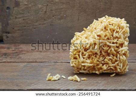 Mixed Crispy Rice Noodle On wood - stock photo