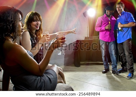 mixed crowd drinking and socializing in a nightclub - stock photo