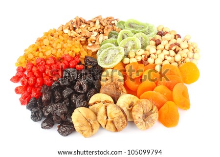 Mixed dried fruits in round shape, health food concept. - stock photo