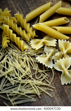 Mixed dried italian pasta collection. Dry pasta background.