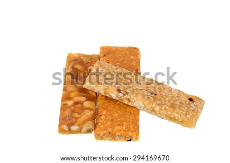 Mixed dry Fruit Cereal Bar on a white background - stock photo