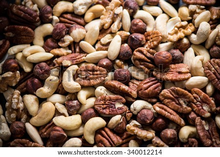mixed dry nuts, food background from above - stock photo