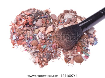 mixed eyeshadows with brush isolated on white background