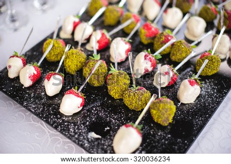 mixed fingerfood and canapes on appetizer table - stock photo