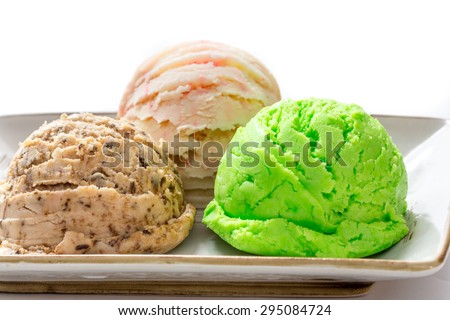 Mixed flavor ice cream scoops in bowl  - stock photo