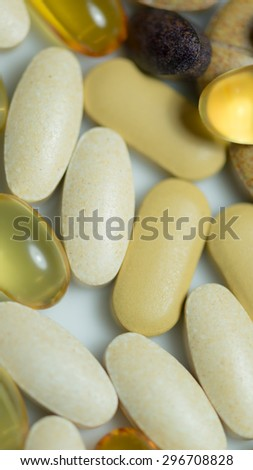 Mixed food supplement pills macro such as  fish oil capsules, vitamin pills , lutein tablet etc. - stock photo