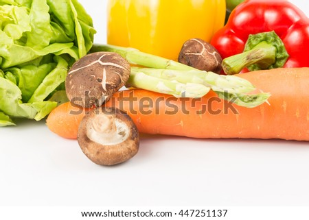 Mixed Fresh Vegetables and fruit on white