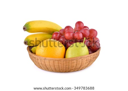 mixed fruit, banana, orange, pear, grape in basket on white background