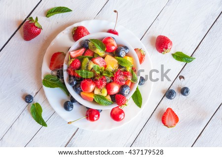 Mixed fruit in a white bowl - stock photo