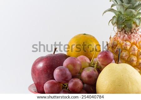 Mixed Fruit including pineapple,grape,orange,apple and century pear in isolate background.