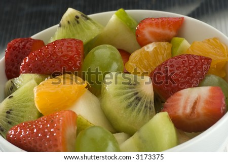 mixed fruit salad in a bowl close up shoot