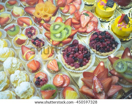 Mixed fruit tart. A custard base tart filling with various fruits on top. - stock photo