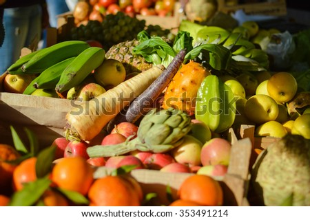 Mixed fruits and vegetables on market stall - stock photo