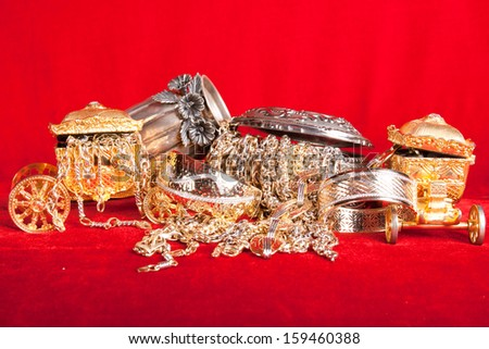 Mixed gold and silver jewelry. treasure chest - stock photo