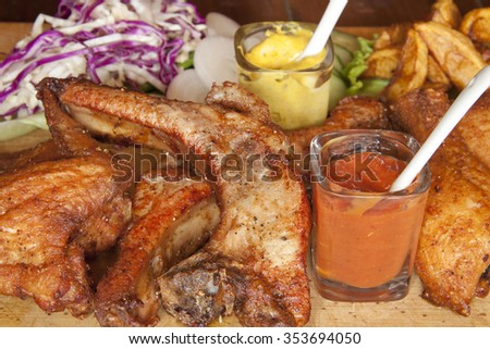 mixed grill on a wooden plate - stock photo
