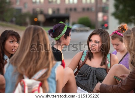 Mixed group of female teenage students in conversation - stock photo