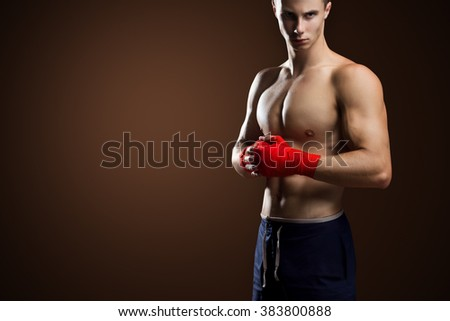 Mixed Martial Arts Fighter Posing On Brown Background - stock photo