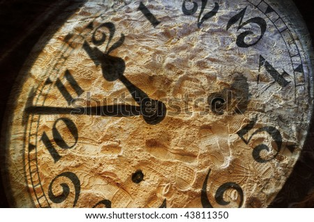 Mixed media image of vintage clock numbers over footsteps in the sand - concept regarding the passage of time - stock photo