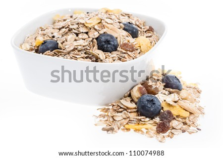 Mixed Muesli in a bowl isolated on white background - stock photo
