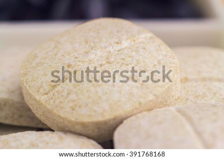 Mixed natural food supplement pills, vitamin c, glucosamine capsules, macro image, selective focus - stock photo