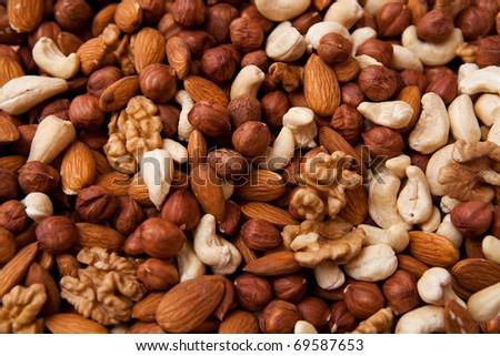 Mixed nuts (almonds, filberts, walnuts, cashews) - stock photo