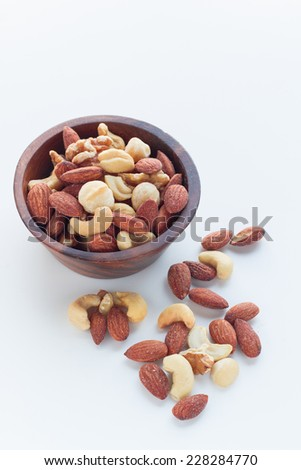 mixed nuts in a bowl isolated on the white background - stock photo