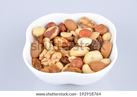 Mixed nuts in a white bowl - stock photo