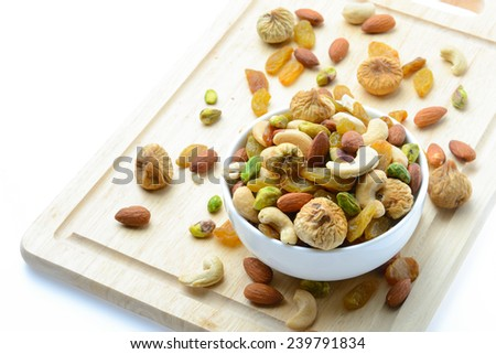 mixed nuts in white bowl on white background - stock photo