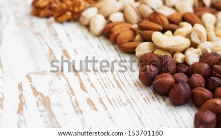 Mixed nuts on a old wooden background - Nuts  frame - stock photo