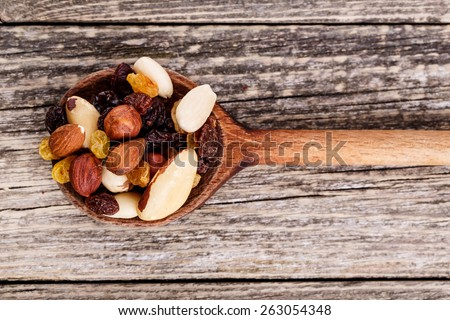 Mixed nuts on a wooden background. - stock photo