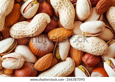 Mixed nuts such as almond, hazelnut and pistachios background texture - stock photo