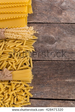 Mixed pasta . On a wooden background. Top view - stock photo