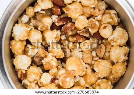 Mixed popcorn with cashew nuts and caramel - stock photo